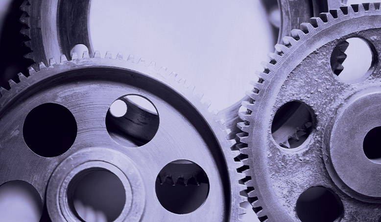 Three gears, meant to represent the inner workings of a tool.